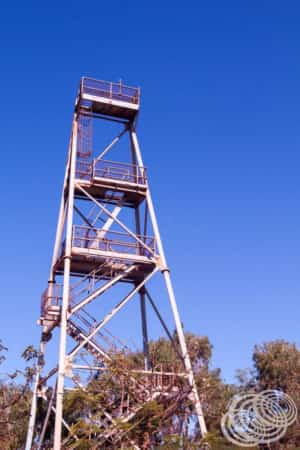An old steel mining headframe behind the visitor information centre