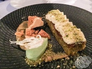 The fennel mousse and almond pistachio orange cake with nut purée, whipped honey, cucumber sorbet, dehydrated fennel, and honeycomb.