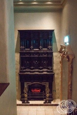 The stunning doorway and fireplace in the Aurora Fountain room