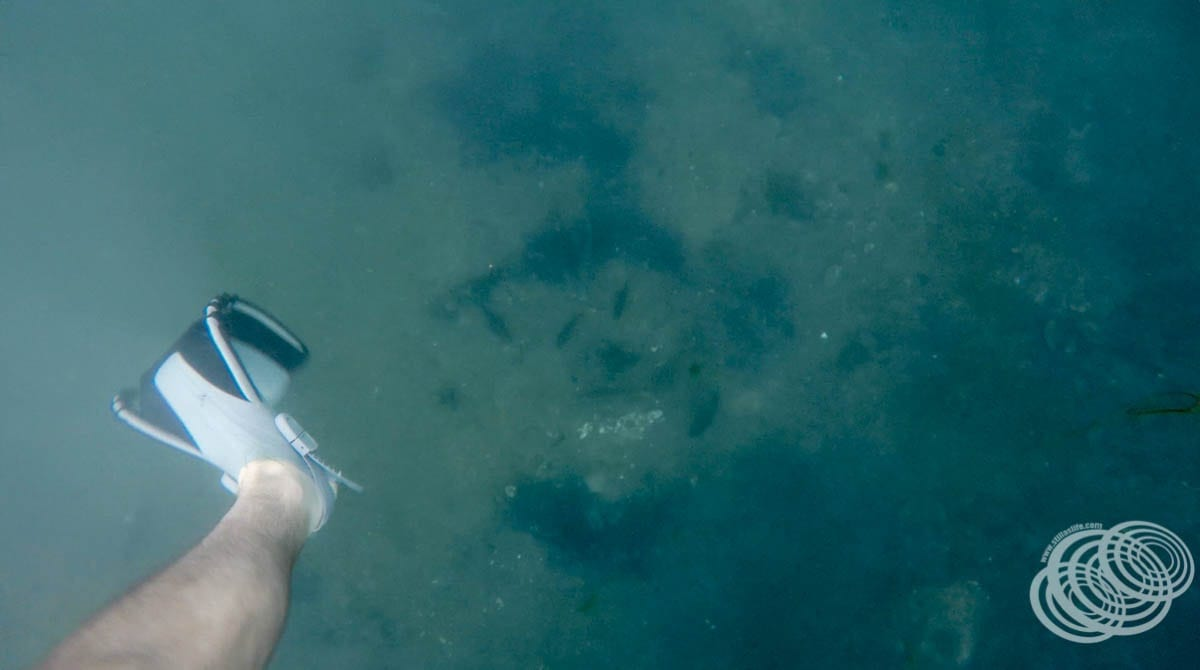 Looking through the clear water towards the bottom, my feet are nowhere close to touching!