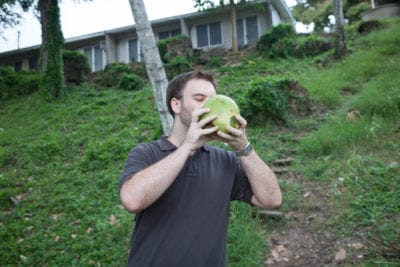 Matt Drinking A Fresh Cut Coconut in the Solomon Islands