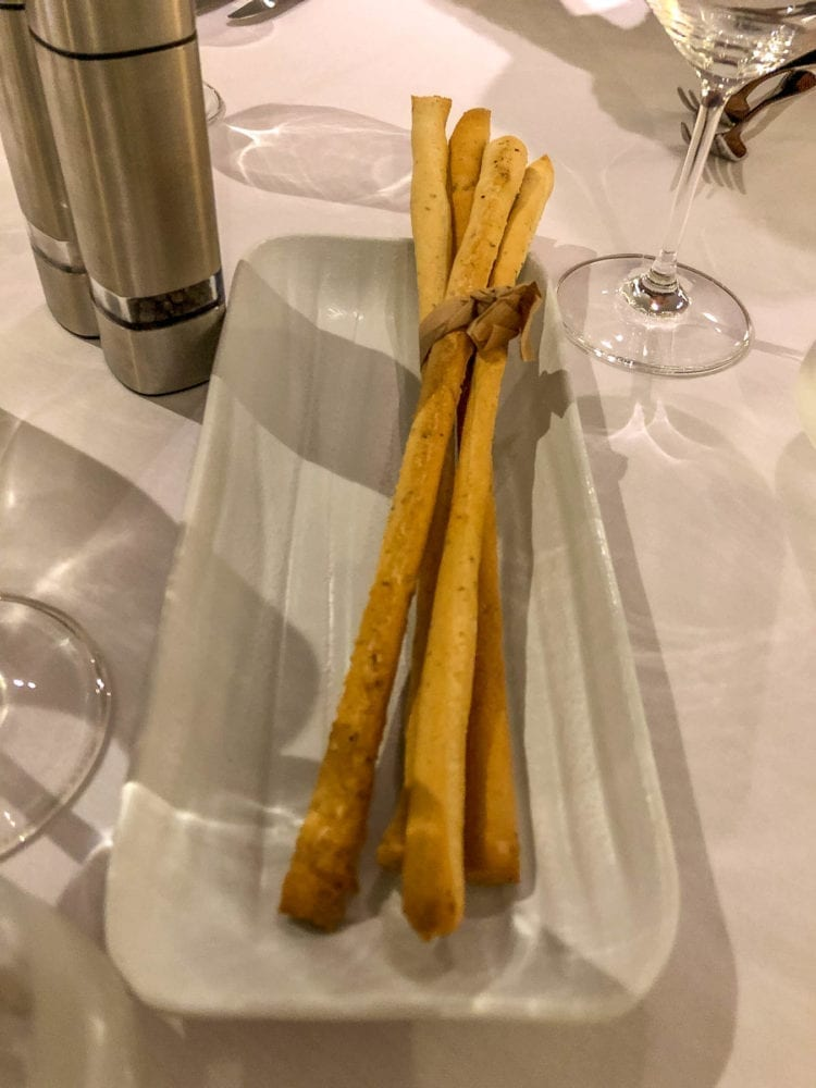 Bread sticks are provided at P&O's Angelo's restaurant while you wait for your food.