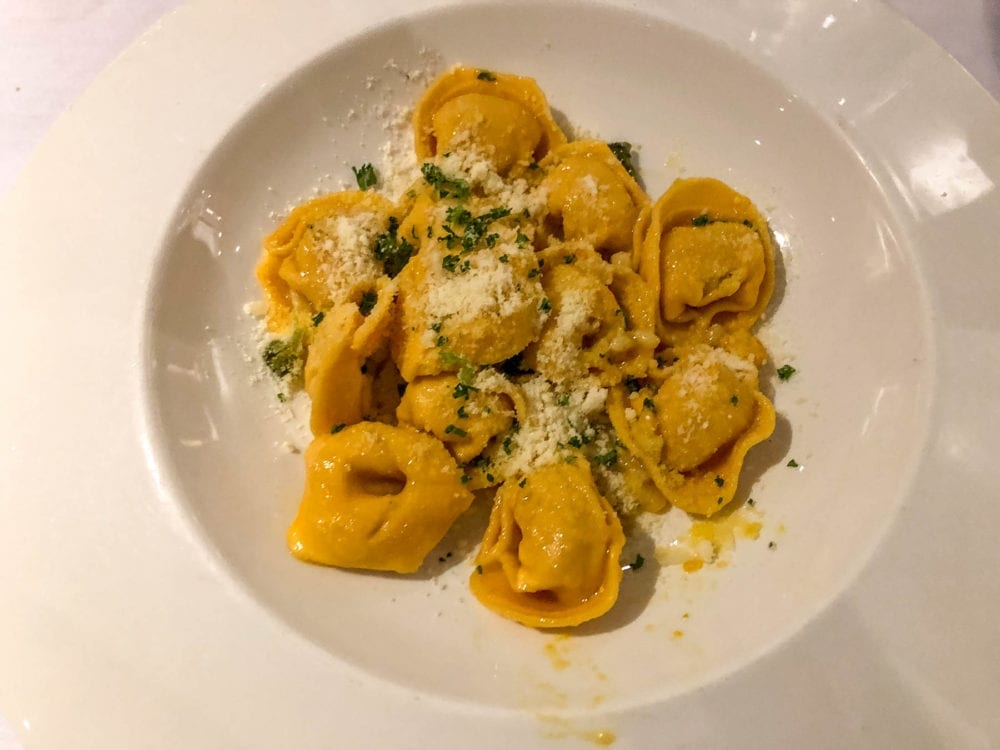 Angelo's Secondi Cappellacci di Zucca Arrosto. This is cappellacci style pasta stuffed with pumpkin and tossed in burnt sage butter and pine nuts.