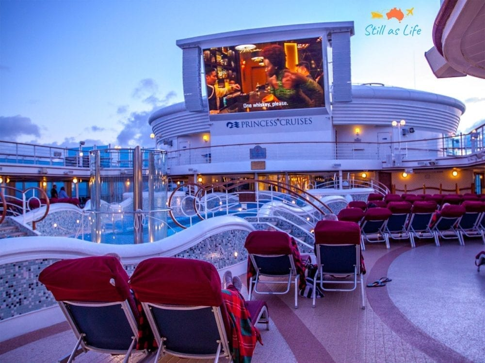 Watching an outdoor movie in the evening on Golden Princess