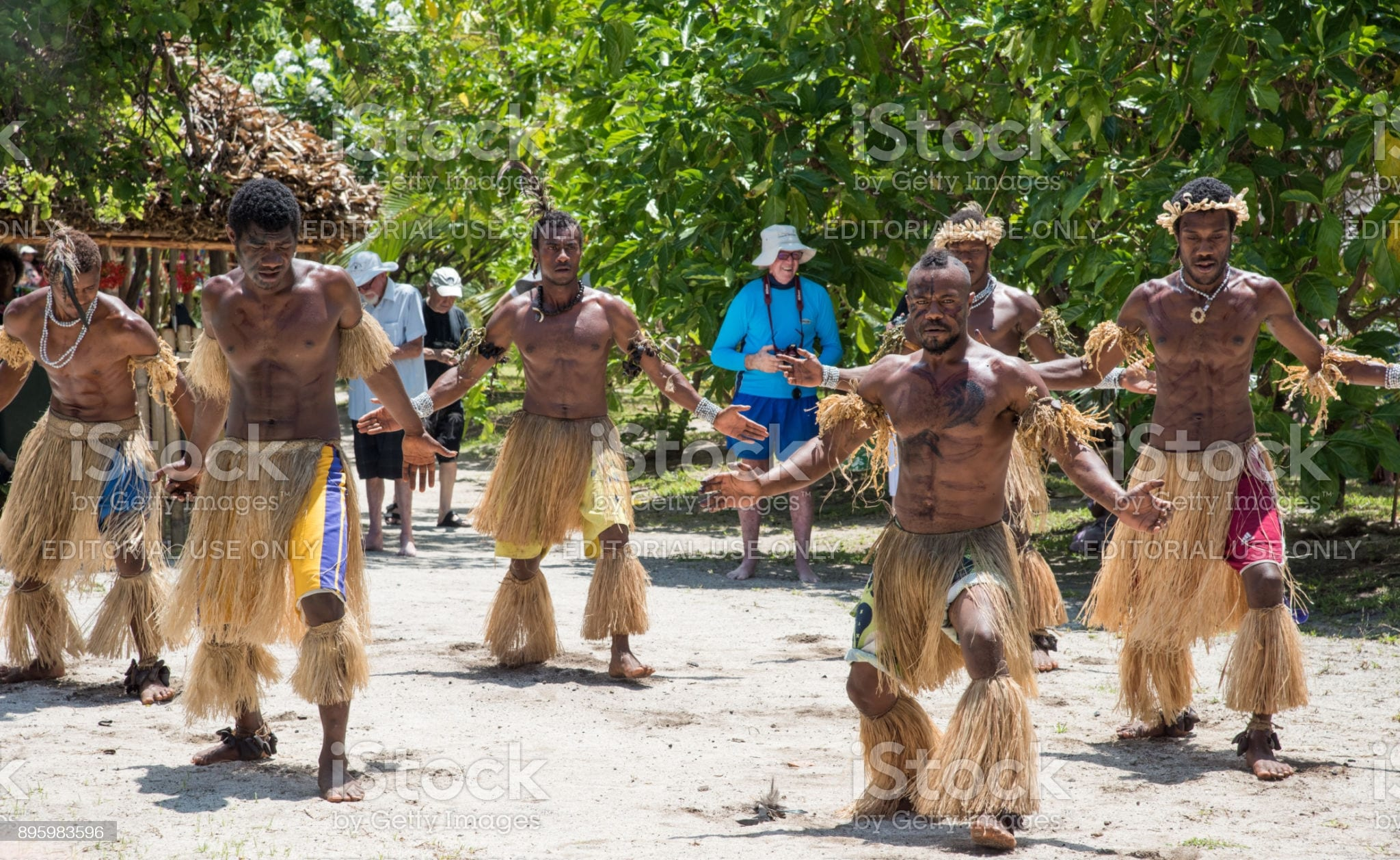 Mystery Island, Vanuatu, Pacific Islands-December 2,2016: Synchronous dance troupe in traditional dress performing on the uninhabited, tropical Mystery Island, Vanuatu
